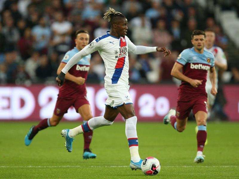 Zaha admits he was unsettled by Arsenal links