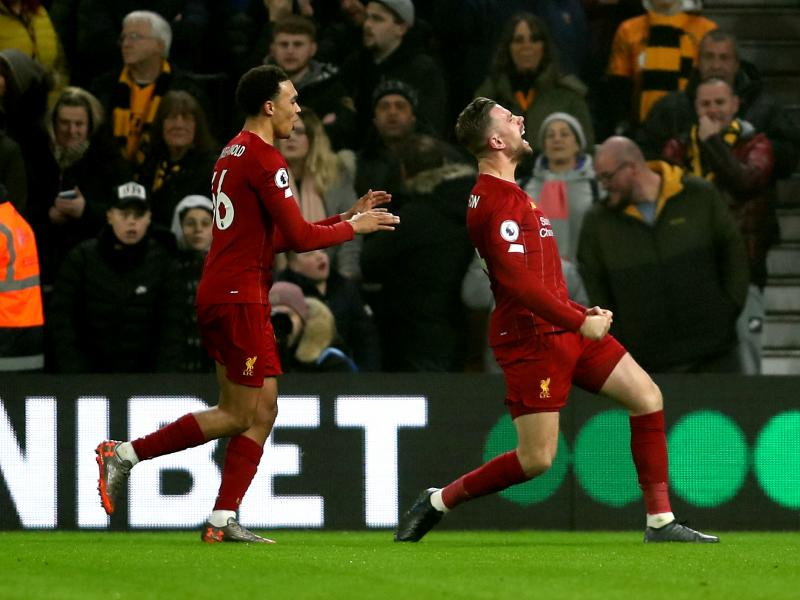 Wolves 1-2 Liverpool: Reds'  title march continues with 14th consecutive win