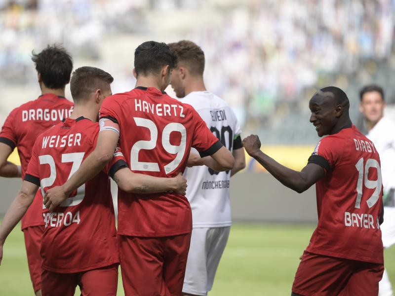 Bundesliga: Leverkusen outscore Gladbach, while Dortmund beat Wolfsburg to close the gap at the top