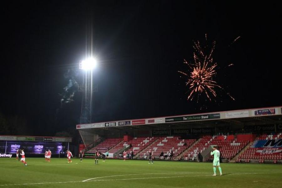 Cheltenham vs Man City paused over player safety concerns as fireworks drop onto pitch