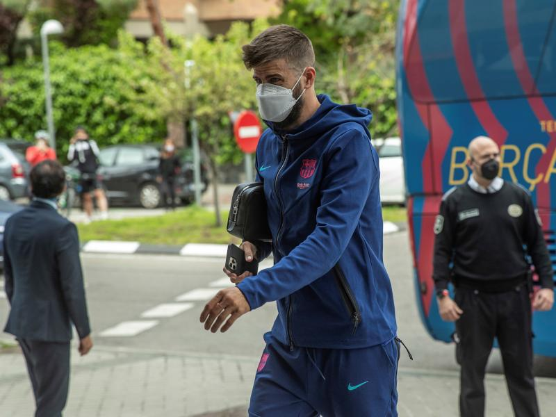 Gerard Pique booked without playing in El Clasico clash