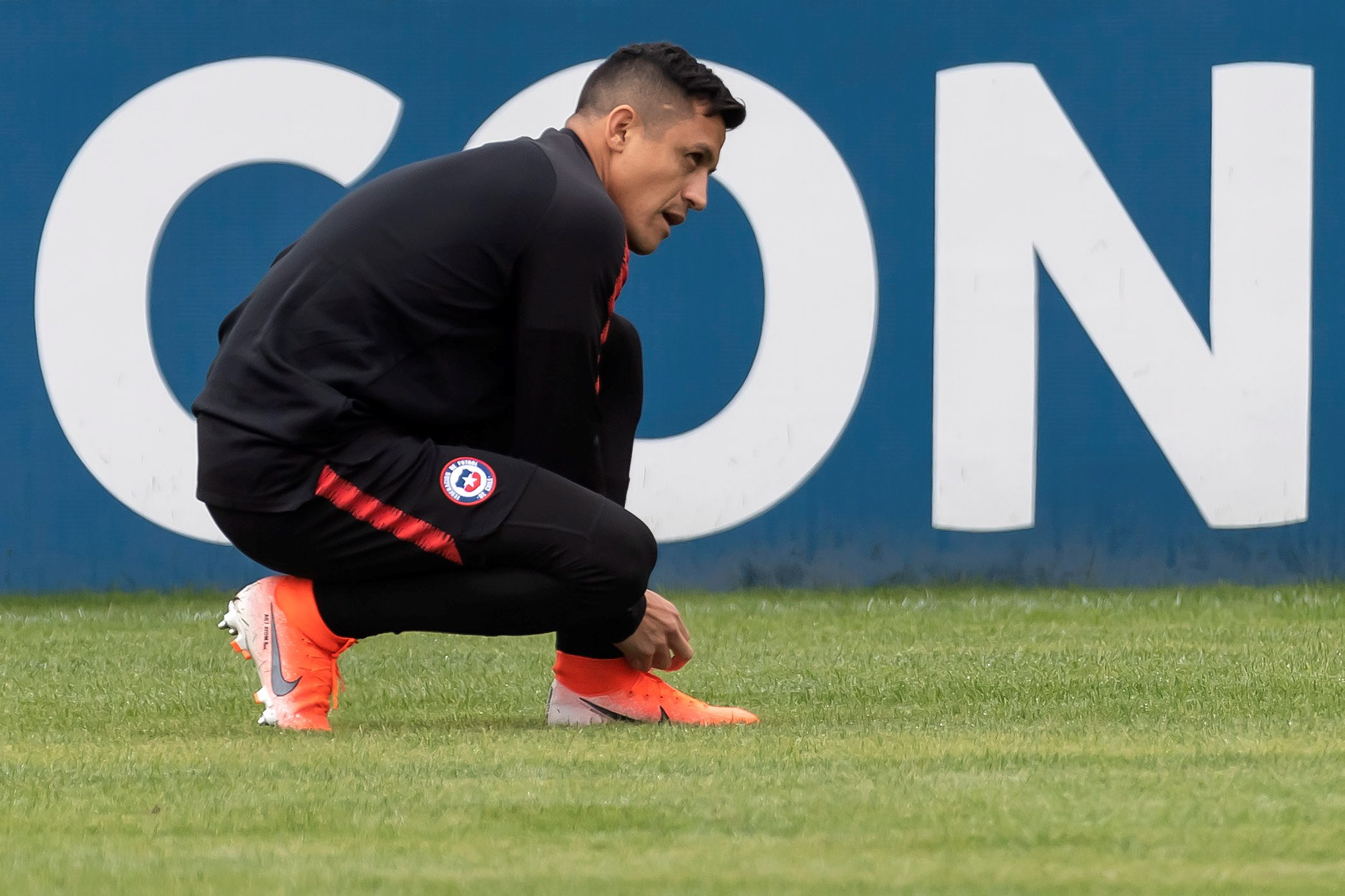 Sanchez in a training burst up with Man United teammate